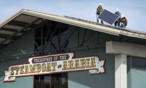 Mark One Electric employees install solar panels at City Market (From The Kansas City Star)